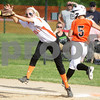 Monica Maschak - mmaschak@shawmedia.com<br /> Rachael Johnson safely makes it to first base when her Harlem opponent misses the ball in the fourth inning of the Class 4A Prairie Ridge Sectional semifinals on Wednesday, May 29, 2013. The Barbs made a comeback to win 4-3.