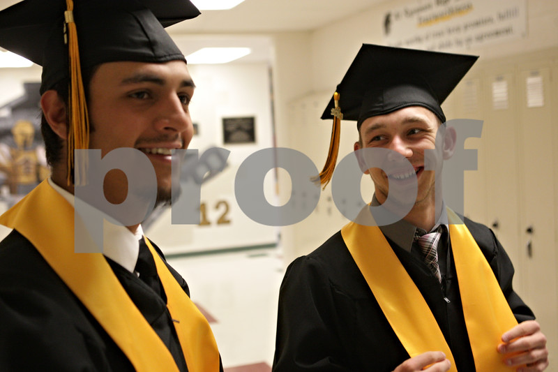 Rob Winner – rwinner@shawmedia.com<br /> <br /> Mitchell Jordan (left) and David Scholz await the start of their graduation ceremony in a hallway near the field house at Sycamore High School on Sunday, May 26, 2013.