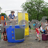 Stephanie Hickman - shickman@shawmedia.com <br />  <br /> Hinckley-Big Rock kindergartner Raven Wagner throws a softball at a target to try to dunk the school's secretary Kim Beitel Tuesday at Hinckley-Big Rock Elementary School. Thirty of the school's teachers and staff agreed to be dunked to reward their students who read more than 17,000 hours this school year.