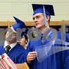 Erik Anderson - For the Daily Chronicle<br /> Graduate Mitch Hemesath, 18, swings a clothes hanger around his finger while fellow graduate, Nick Gentry, 17, stands off to the left before heading to the gym for the graduation ceremony at Hinckley-Big Rock High School in Hinckley on Sunday, May 26, 2013.