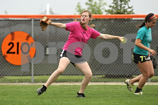 Rob Winner – rwinner@shawmedia.com<br /> <br /> DeKalb's Morgan Newport throws a ball back in during outfield practice drill in DeKalb, Ill., Tuesday, May 28, 2013.