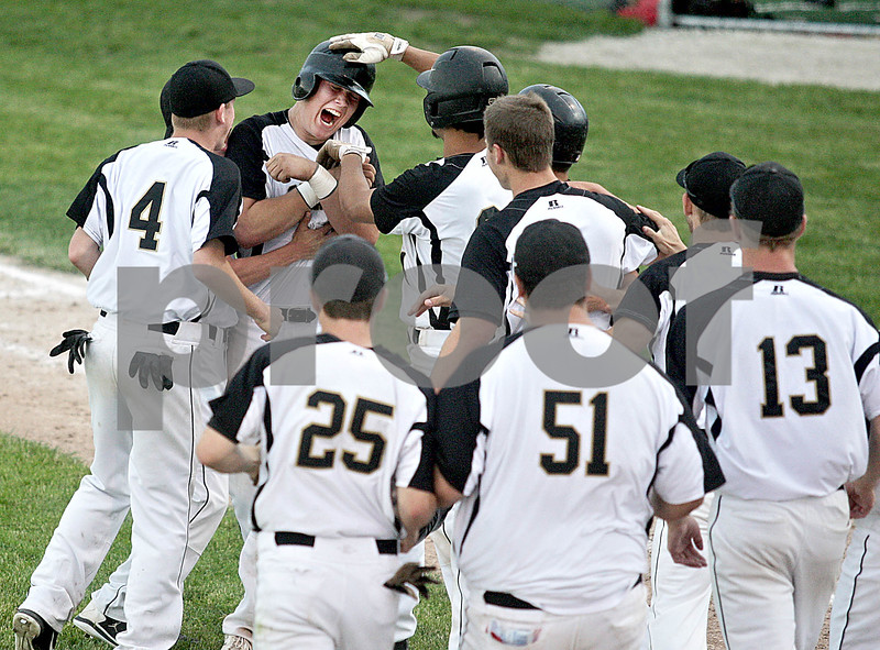Monica Maschak - mmaschak@shawmedia.com<br /> The team congratulates Brett Weaver after making the game-winning hit in the sixth inning of the Class 3A Sycamore Sectional semifinals against Rockford East on Thursday, May 30, 2013. The Spartans shutout the E-Rabs 10-0 in six innings.