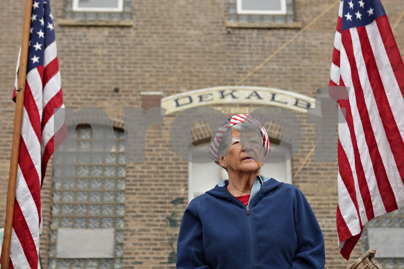 Rob Winner – rwinner@shawmedia.com<br /> <br /> DeKalb resident Donna Bennett listens as the Memorial Day service begins at Memorial Park at the corner of North First Street and Lincoln Highway in downtown DeKalb, Ill.<br /> <br /> Monday, May 27, 2013