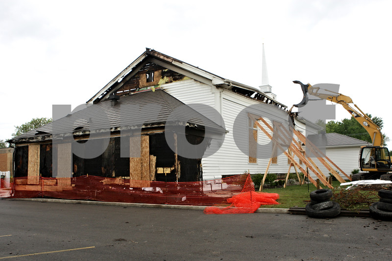 Rob Winner – rwinner@shawmedia.com<br /> <br /> The exterior of St. Paul The Apostle Catholic Church in Sandwich, Ill. is seen on Wednesday, May 29, 2013. A fire on Monday, May 20, 2013 destroyed much of the building.