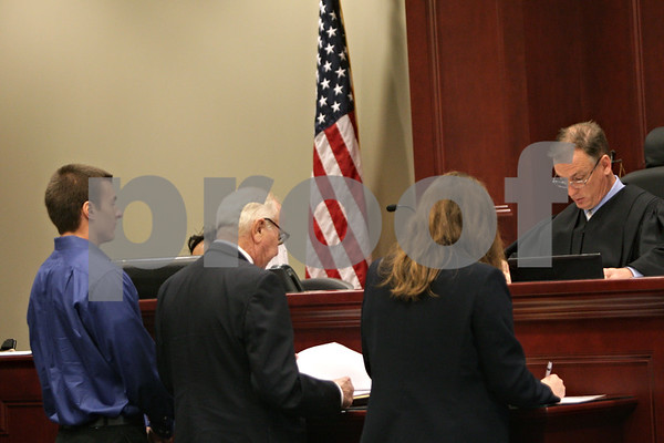 Rob Winner – rwinner@shawmedia.com<br /> <br /> Alexander M. Jandick (left), of Naperville, formally pleaded not guilty to hazing charges Tuesday, May 28, 2013 in DeKalb County Court in Sycamore, Ill.  Jandick was president of Pi Kappa Alpha fraternity in November when freshman pledge David Bogenberger died during a pledge-related drinking party at the fraternity.