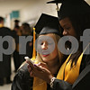 Rob Winner – rwinner@shawmedia.com<br /> <br /> Marley Hawkins (left) and Emerald Vaughn look over some photographs on a phone before Sunday's commencement at Sycamore High School.