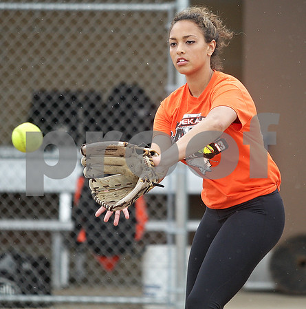 Monica Maschak - mmaschak@shawmedia.com<br /> Jessica Townsend catches a ball during a rainy practice at DeKalb High School on Friday, May 31, 2013. The softball team will compete in the Class 4A Prairie Ridge Sectional final Saturday morning.