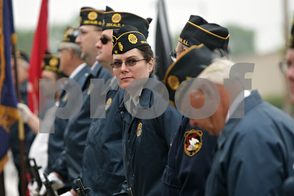 Rob Winner – rwinner@shawmedia.com<br /> <br /> DeKalb resident and Army veteran Margaret McCann awaits the start of a Memorial Day service at Memorial Park at the corner of North First Street and Lincoln Highway in downtown DeKalb, Ill.<br /> <br /> Monday, May 27, 2013