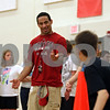 Rob Winner – rwinner@shawmedia.com<br /> <br /> Northern Illinois cornerback and former Sycamore High School running back Marckie Hayes interacts with students at Sycamore Middle School during their field day on Wednesday, May 29, 2013.