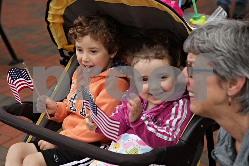 Rob Winner – rwinner@shawmedia.com<br /> <br /> (From left to right) Jack Fisher, 4, his sister, Eloise Fisher, 3, both of DeKalb, and grandmother, Diane Landry, of South Haven, Mich., watch as DeKalb's Memorial Day parade travels west on Lincoln Highway in downtown DeKalb, Ill.<br /> <br /> Monday, May 27, 2013