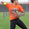 Monica Maschak - mmaschak@shawmedia.com<br /> Jessica Townsend throws a ball during a rainy practice at DeKalb High School on Friday, May 31, 2013. The softball team will compete in the Class 4A Prairie Ridge Sectional final Saturday morning.