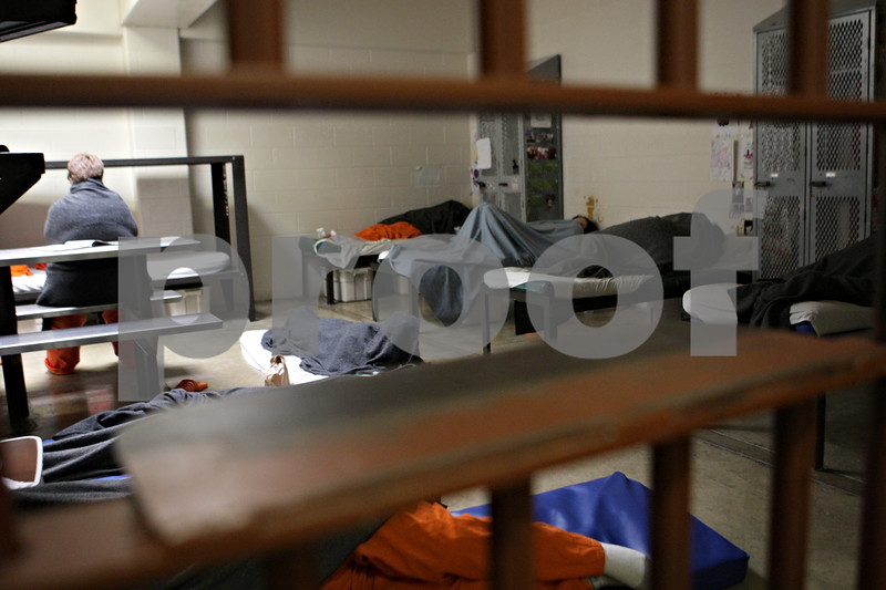 Rob Winner – rwinner@shawmedia.com<br /> <br /> Women inmates are seen in the crowded T-Block at the DeKalb County jail in Sycamore, Ill., Tuesday, May 28, 2013. Some of the inmates sleep on the floor because of the space issues the jail faces.