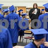Erik Anderson - For the Daily Chronicle<br /> Class Advisor Mrs. Kim Halverson speaks to the graduates about final questions and conducts the grads to get in their correct order before heading out to the gym at Hinckley-Big Rock High School in Hinckley on Sunday, May 26, 2013.