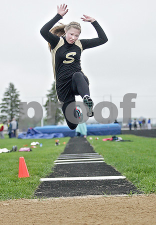 Monica Maschak - mmaschak@shawmedia.com<br /> Sycamore's Lilia Edwards eyes her landing at her second attempt in the long jump at a Class 2A Burlington Central Sectional track meet on Friday, May 10, 2013.