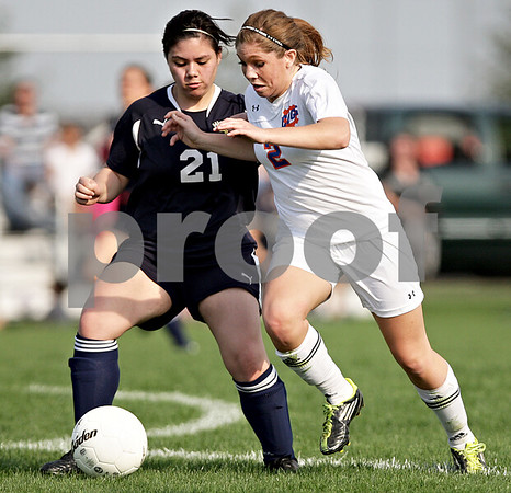 Monica Maschak - mmaschak@shawmedia.com<br /> Genoa-Kingston's Shannon Schumacher and Hiawatha's Francis Elmore confront the ball in the Class 1A Genoa-Kingston Regional semifinal game on Wednesday, May 8, 2013. The Cogs beat Hiawatha 4-1.