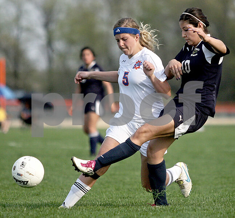 Monica Maschak - mmaschak@shawmedia.com<br /> Yulissa Solis kicks the ball before Katie McCluskey (5) has time to reach it during the Class 1A Genoa-Kingston Regional semifinal game on Wednesday, May 8, 2013. The Cogs beat Hiawatha 4-1.