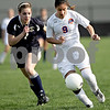Monica Maschak - mmaschak@shawmedia.com<br /> Ixtel Viramontes dribbles the ball in the Class 1A Genoa-Kingston Regional semifinal game on Wednesday, May 8, 2013. The Cogs beat Hiawatha 4-1.