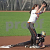 Monica Maschak - mmaschak@shawmedia.com<br /> DeKalb's Sarah Friedlund catches a ball in an attempt to tag out Sycamore's Taylor Jones in a rivalry game at Northern Illinois University on Tuesday, May 7, 2013. The Barbs beat the Spartans 4-3.