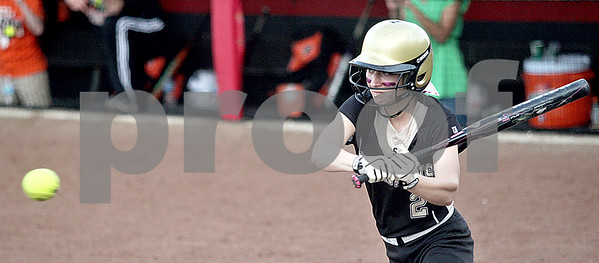 Monica Maschak - mmaschak@shawmedia.com<br /> Sycamore's Tristyn Criswell swings for the ball in a rivalry game at Northern Illinois University on Tuesday, May 7, 2013. The Barbs beat the Spartans 4-3.