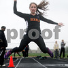 Monica Maschak - mmaschak@shawmedia.com<br /> Stephanie Milroy gets air in the triple jump event at a Class 3A Belvidere North Sectional on Thursday, May 9, 2013. Milory finished eighteenth with 30 feet, 8 inches.