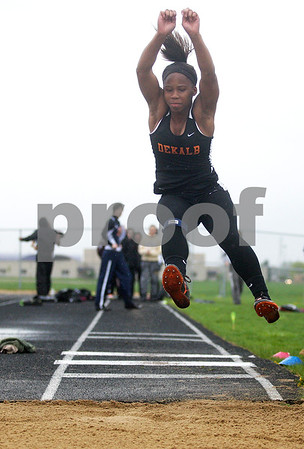 Monica Maschak - mmaschak@shawmedia.com<br /> Brittney Patrick eyes her landing in the long jump event at a Class 3A Belvidere North Sectional on Thursday, May 9, 2013. Patrick took fourth with 16 feet, 9.25 inches.