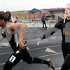 Monica Maschak - mmaschak@shawmedia.com<br /> Alex Sammer hands off the baton to Brittney Patrick in the last leg of the 4x100 meter race at a Class 3A Belvidere North Sectional on Thursday, May 9, 2013. DeKalb finished fifth with 51.7 seconds.