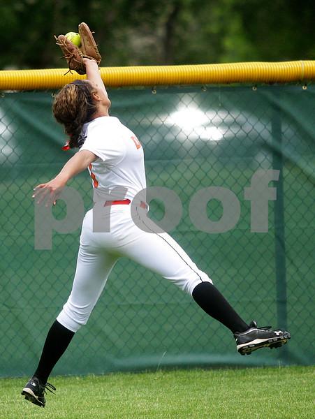 Monica Maschak - mmaschak@shawmedia.com<br /> Jessica Townsend leaps to catch a ball behind her in the third inning of the Class 4A Prairie Ridge Sectional final against Warren on Saturday, June 1, 2013. DeKalb lost 6-1.
