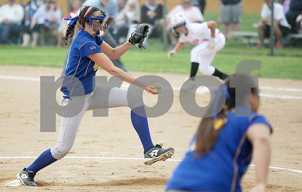 Monica Maschak - mmaschak@shawmedia.com<br /> Jana Wagner steps into her pitch in the first inning of the Class 4A Prairie Ridge Sectional final against Warren on Saturday, June 1, 2013. DeKalb lost 6-1.