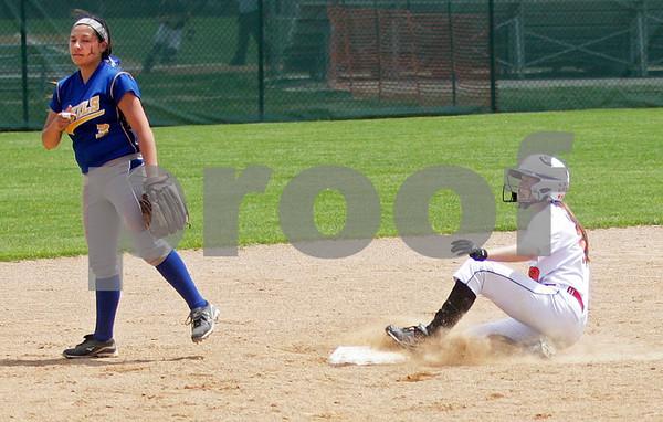 Monica Maschak - mmaschak@shawmedia.com<br /> Morgan Newport slides into second base in the sixth inning of the Class 4A Prairie Ridge Sectional final against Warren on Saturday, June 1, 2013. DeKalb lost 6-1.