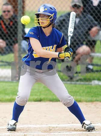 Monica Maschak - mmaschak@shawmedia.com<br /> Megan Sowa eyes a high ball in the first inning of the Class 4A Prairie Ridge Sectional final against Warren on Saturday, June 1, 2013. DeKalb lost 6-1.