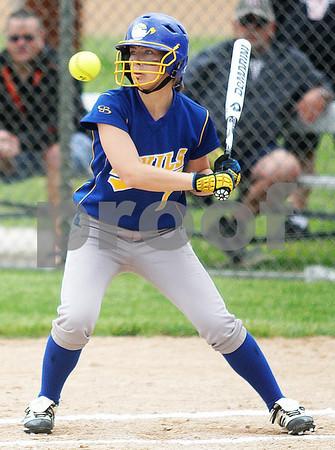 Monica Maschak - mmaschak@shawmedia.com<br /> Megan Sowa eyes a high ball in the first inning of the Class 4A Prairie Ridge Sectional final against Warren on Saturday, June 1, 2013. DeKalb lost 6-1.