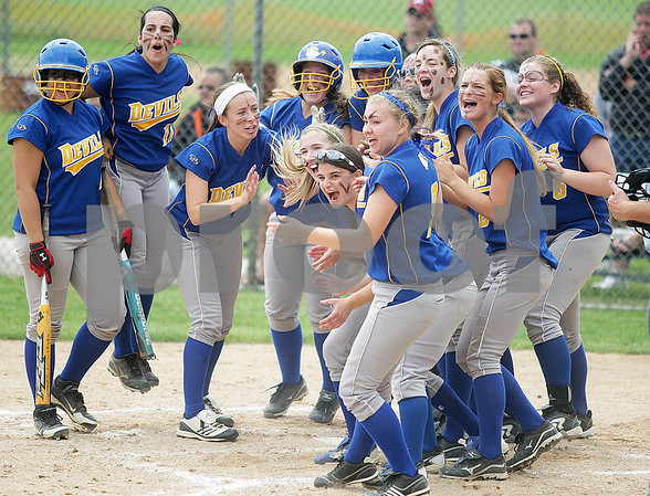 Monica Maschak - mmaschak@shawmedia.com<br /> The Blue Devils crowd around home plate to congratulate Sam Belletini on her home-run hit in the fourth inning of the Class 4A Prairie Ridge Sectional final against Warren on Saturday, June 1, 2013. Warren won 6-1.