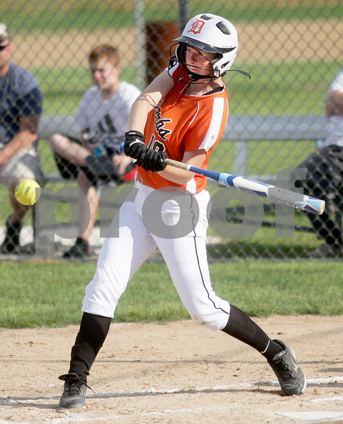 Monica Maschak - mmaschak@shawmedia.com<br /> DeKalb's Morgan Newport swings for the ball against Harlem in the seventh inning of the Class 4A Prairie Ridge Sectional semifinals on Wednesday, May 29, 2013. The Barbs made a comeback to win 4-3.