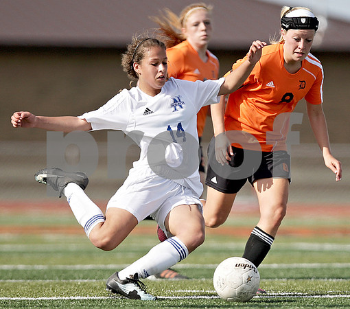Monica Maschak - mmaschak@shawmedia.com<br /> St. Charles North's Lizzie Parrilli winds up to kick the ball before DeKalb's Carlie Hayes can get to it during the Class 3A DeKalb Regional semifinals on Wednesday, May 15, 2013. The North Stars beat The Barbs 5-1.