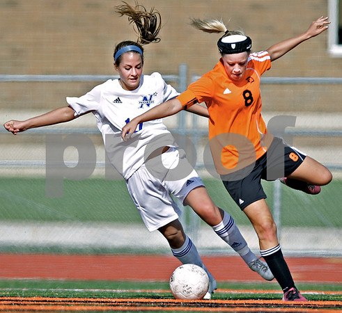 Monica Maschak - mmaschak@shawmedia.com<br /> Carlie Hayes, for DeKalb, and Jorie Clawson, for St. Charles North, dance for the ball in the Class 3A DeKalb Regional semifinals on Wednesday, May 15, 2013. The North Stars beat The Barbs 5-1.