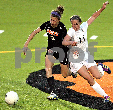 Monica Maschak - mmaschak@shawmedia.com<br /> Alyssa Maillefer gets physical for the ball against Freeport during the Class 2A Freeport Sectional semifinals in Freeport, Ill., Tuesday, May 22, 2013. Sycamore lost 8-1.