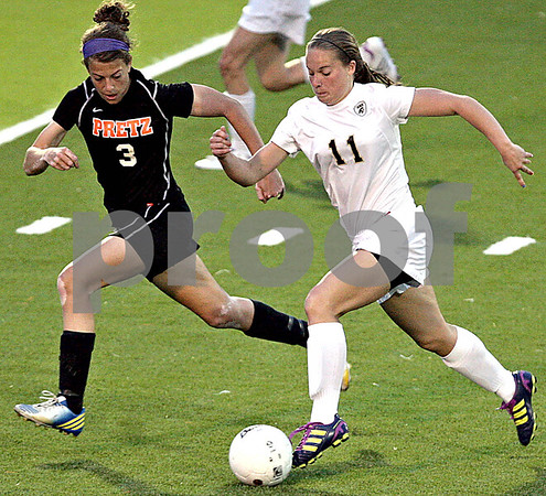 Monica Maschak - mmaschak@shawmedia.com<br /> <br /> Alyssa Maillefer dribbles with Freeport pressure on her right during the Class 2A Freeport Sectional semifinals in Freeport, Ill., Tuesday, May 22, 2013. Sycamore lost 8-1.