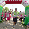Monica Maschak - mmaschak@shawmedia.com<br /> Third grader from James R. Wood Elementary School Maggie Roberts crosses the finish line first with her running buddy and aunt, Brigid DeBruycker in the area's first Girls on the Run 5K race at Hopkins Park in DeKalb on Saturday, May 18, 2013. Girls on the Run is a national program that encourages girls in grades 3-5 to avoid gossiping and bullying and promotes making better, heathier decisions. Around 111 girls ran the race along with their running buddies and other community members.