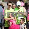 Monica Maschak - mmaschak@shawmedia.com<br /> Fourth grader from Somonauk Elementary School Anna Valela receives a hug from her running buddy and brother Peter Valela Jr. and congratulations from her father, Peter Valela, and little brother, Asa Valela after completing the area's first Girls on the Run 5K race at Hopkins Park in DeKalb on Saturday, May 18, 2013. Girls on the Run is a national program that encourages girls in grades 3-5 to avoid gossiping and bullying and promotes making better, heathier decisions. Around 111 girls ran the race along with their running buddies and other community members.