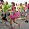 "Monica Maschak - mmaschak@shawmedia.com<br /> About 111 girls, their running buddies and community members took off on the area's first Girls on the Run 5K race at Hopkins Park at 8:30 a.m. on Saturday, May 18, 2013. Girls on the Run is a national program that encourages girls in grades 3-5 to avoid gossiping and bullying and promotes making better, heathier decisions. The back of the runners' shirts read, ""I am strong. I am beautiful. I am worth it."""