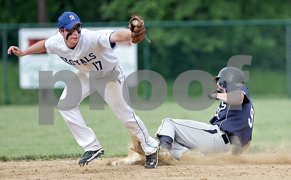 Monica Maschak - mmaschak@shawmedia.com<br /> Hinckley-Big Rock's Jake Schrader catches the ball as Hiawatha's Nick Doolittle slides into second base in a Class A Hinckley-Big Rock Regional finals game at Kenny Field on Saturday, May 18, 2013. Hiawatha won 6-5.