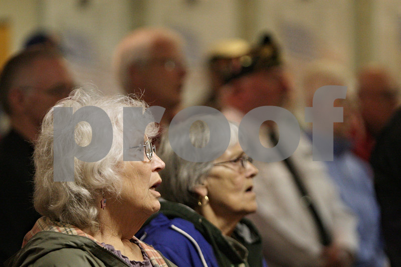 """Rob Winner – rwinner@shawmedia.com<br /> <br /> Sycamore residents and friends Susan Lloyd (left) and Myrna Egerman sing """"God Bless America"""" during a Memorial Day service at the Sycamore Veterans Home.<br /> <br /> Sycamore, Ill.<br /> Monday, May 27, 2013"""
