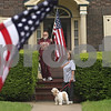 Rob Winner – rwinner@shawmedia.com<br /> <br /> Sycamore residents Robert and Lois Self watch as the Memorial Day parade travel toward Elmwood Cemetery on Charles Street in Sycamore, Ill. on Monday, May 27, 2013.