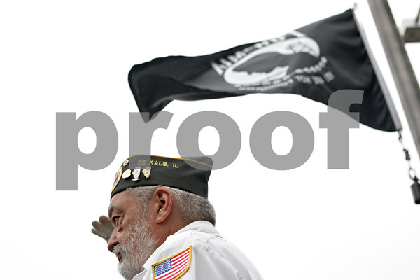 "Rob Winner – rwinner@shawmedia.com<br /> <br /> Marine Corps veteran Tom Carey salutes as ""Taps"" is heard from a bugle during a Memorial Day service at Memorial Park at the corner of North First Street and Lincoln Highway in downtown DeKalb, Ill.<br /> <br /> Monday, May 27, 2013"