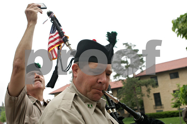 Rob Winner – rwinner@shawmedia.com<br /> <br /> Tom Murphy (left) helps tune Eric Blanken's bagpipes before the start of the Memorial Day parade near the corner of North Third Street and Lincoln Highway in downtown DeKalb, Ill.<br /> <br /> Monday, May 27, 2013<br /> both from DeKalb