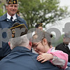 Rob Winner – rwinner@shawmedia.com<br /> <br /> Desert Storm Army veteran Mike Henning is hugged by his stepdaughter, Bobbie Henning, 5, before the start of DeKalb's Memorial Day parade in downtown DeKalb, Ill.<br /> <br /> Monday, May 27, 2013
