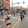 Rob Winner – rwinner@shawmedia.com<br /> <br /> Baton twirler Allison Hunter-Rosene leads the DeKalb High School marching band west on Lincoln Highway during Monday's Memorial Day parade in downtown DeKalb, Ill.<br /> <br /> Monday, May 27, 2013