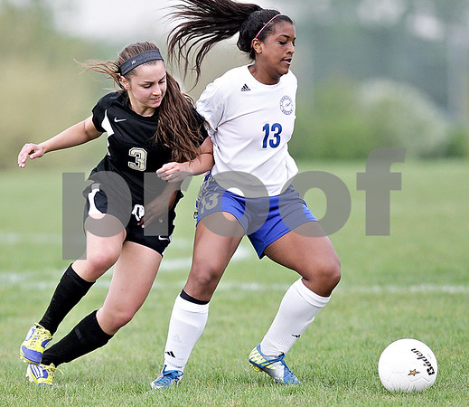 Monica Maschak - mmaschak@shawmedia.com<br /> Amy Schroeder goes arm-in-arm with her opponent for the ball in the Class 2A Sycamore Regional finals against Burlington on Friday, May 17, 2013. The Spartans won 1-0.