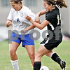Monica Maschak - mmaschak@shawmedia.com<br /> Katherine Kohler collides with an opponent in the Class 2A Sycamore Regional finals against Burlington on Friday, May 17, 2013. The Spartans won 1-0.