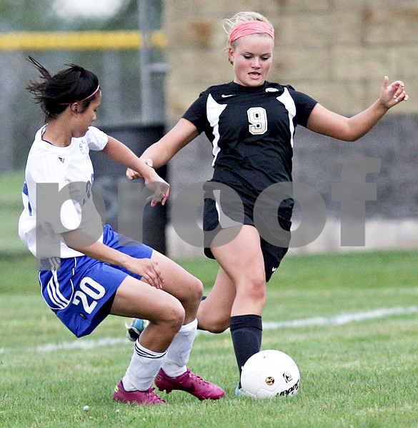 Monica Maschak - mmaschak@shawmedia.com<br /> Alexis Divita races her opponent to the ball in the Class 2A Sycamore Regional finals against Burlington on Friday, May 17, 2013. The Spartans won 1-0.